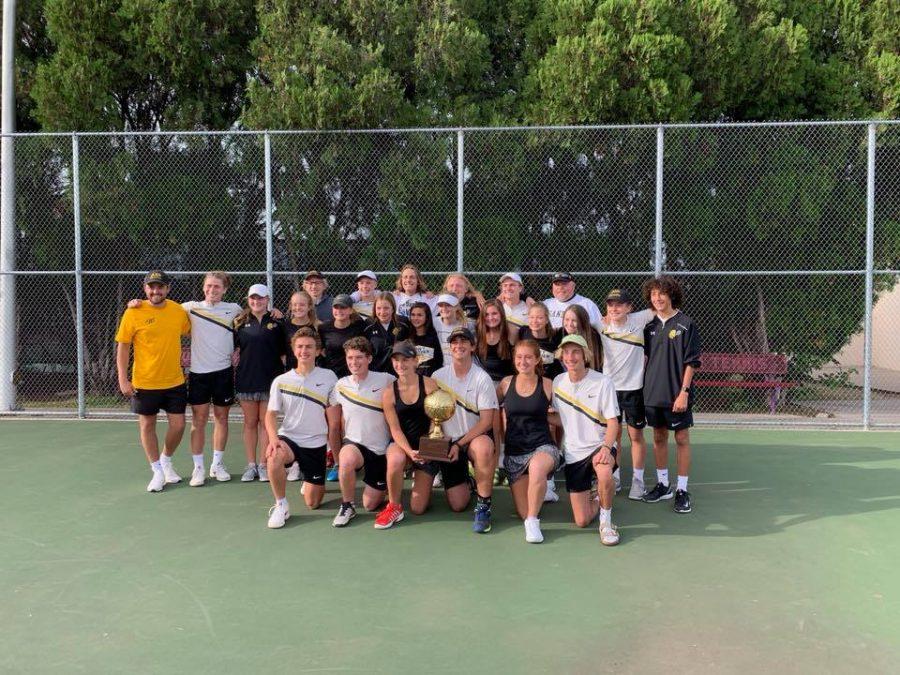 The Tennis team poses with their Regional Quarterfinals plaque.
