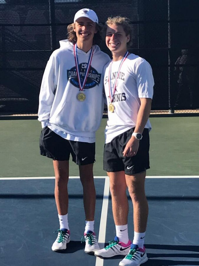 Tauber Smith and Jackson Harwell pose with their Regional Champions medal.