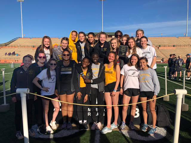 Varsity girls track poses with their win at the Amarillo Relays
