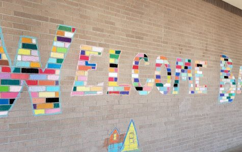 The art mural welcomes students back to school.