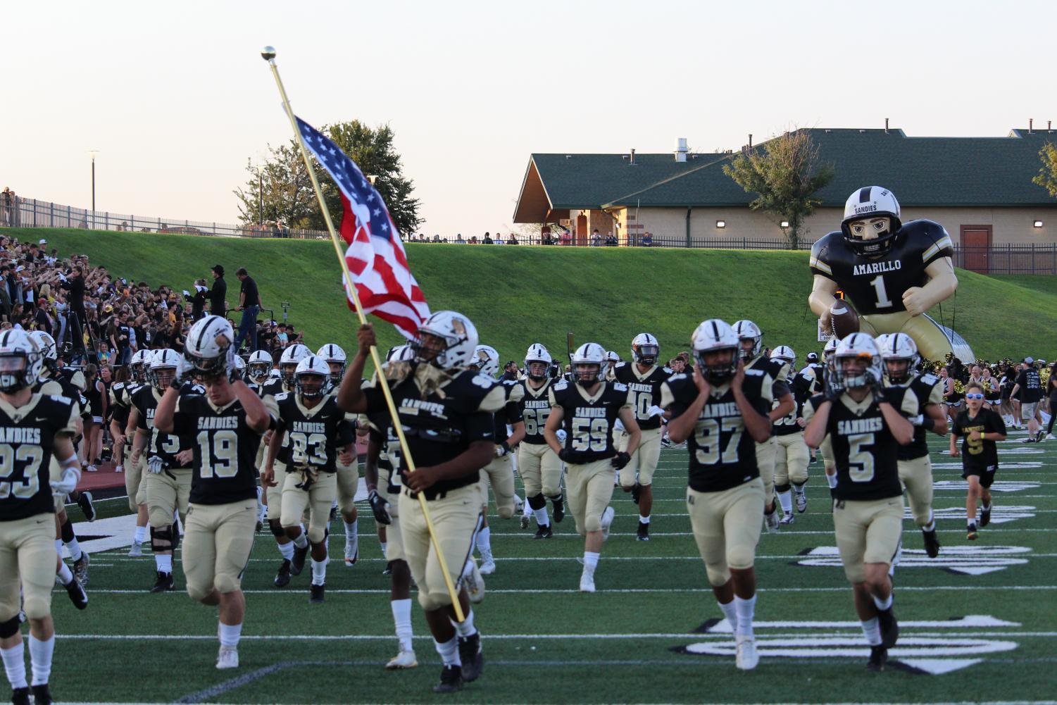 Sandies run onto the field at the start of the game