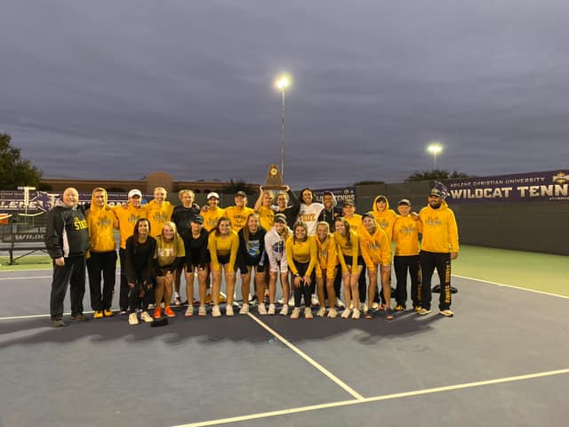 tennis team poses with their region trophy