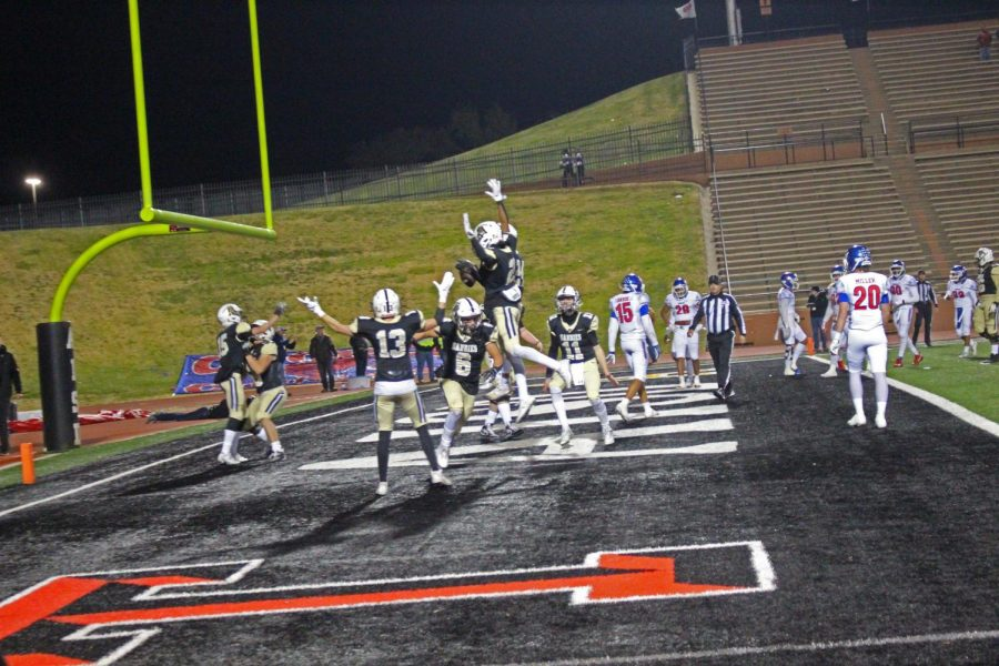 Players+celebrate+in+the+endzone+after+an+early+touchdown
