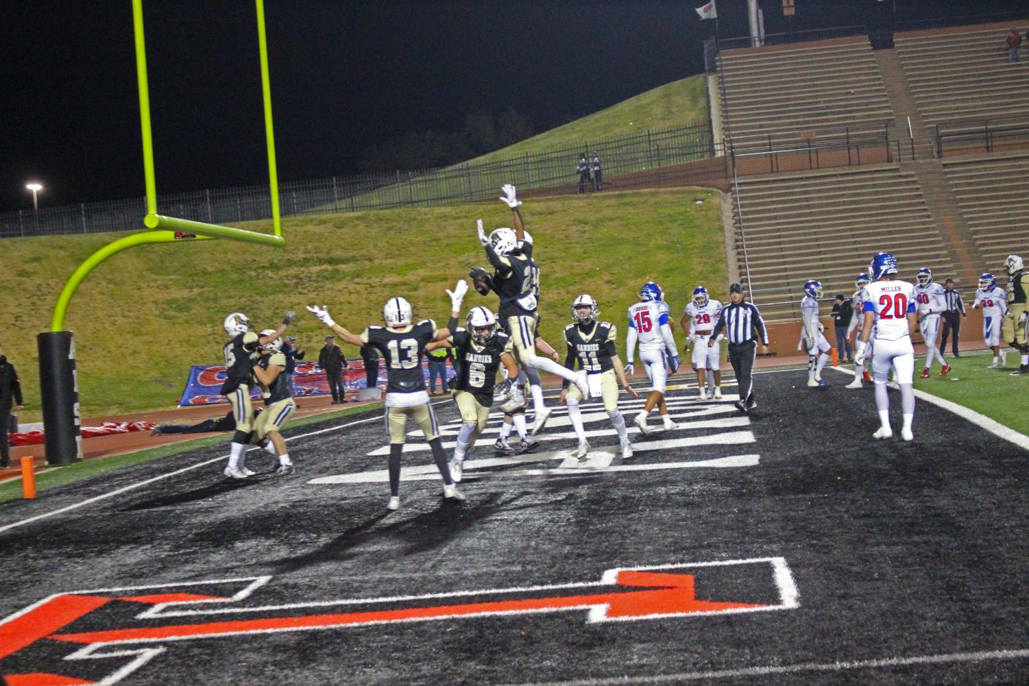 Players celebrate in the endzone after an early touchdown