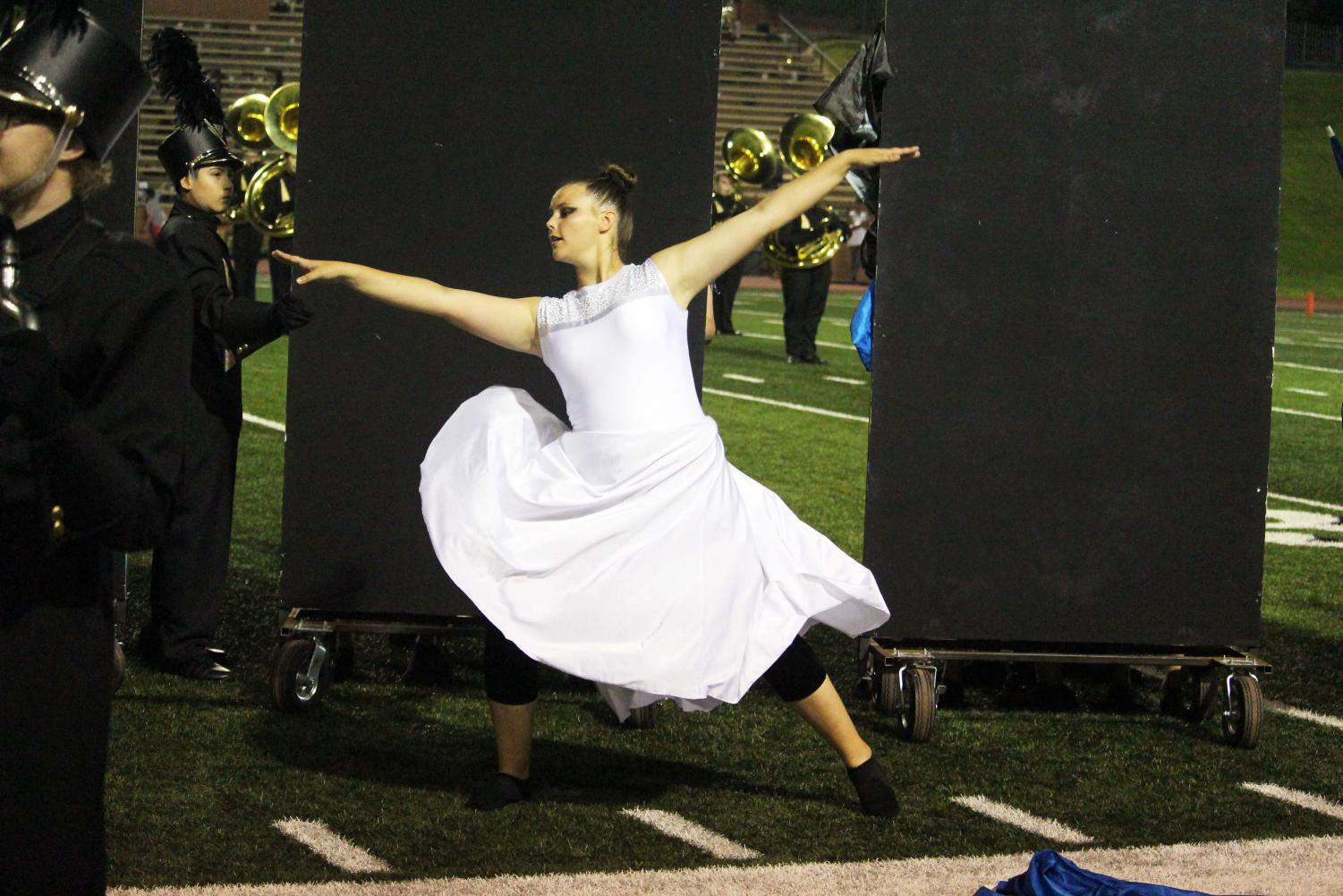 Aaryn Bivins performs at a halftime show  during The Annabelle Lee section of the show.