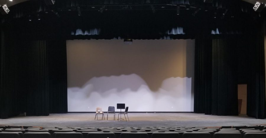 The auditorium stage, usually full of stage pieces and props for the fall production, is empty after the cancellation of the fall production