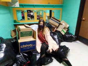 Klair Soukup takes a break while cleaning and organizing the new theatre space. The cancellation of the fall production has allowed the production students to clean out the space.