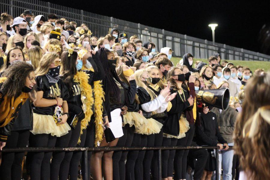 The football ladies cheer on the Sandies at the Spirit Week game against Tascosa